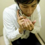 man making a phone call secretly in toilet